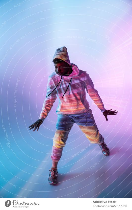Male dancer under bright light Dancer Man Movement Light Youth (Young adults) Modern Style Action Energy Power Contemporary Hip & trendy pose Bright flexibility