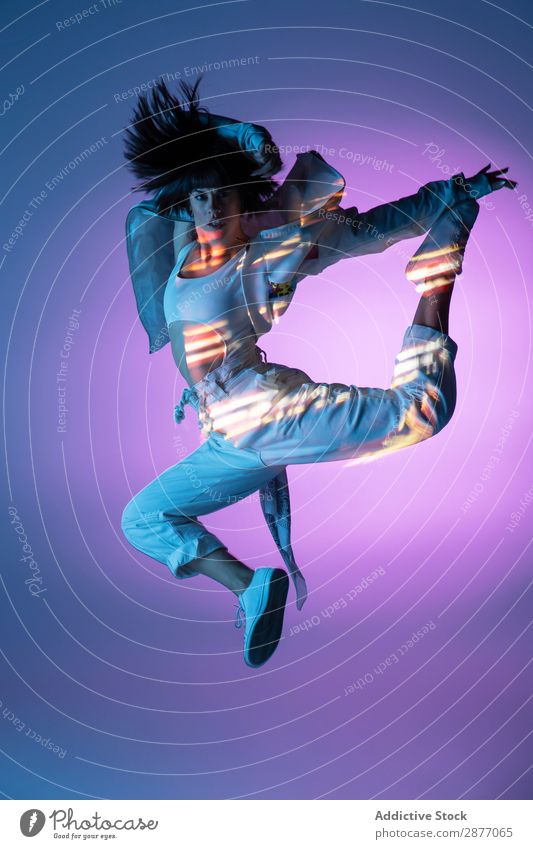 Energetic dancer jumping and looking at camera Dancer Woman Jump Movement Light Youth (Young adults) Modern Style Action Energy Power Contemporary Hip & trendy