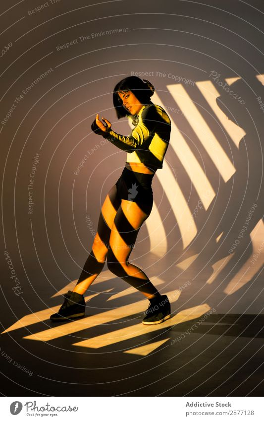 Sensual woman dancing under bright light Dancer Woman Movement Light Youth (Young adults) To enjoy Modern Style Action Contemporary Hip & trendy pose Bright