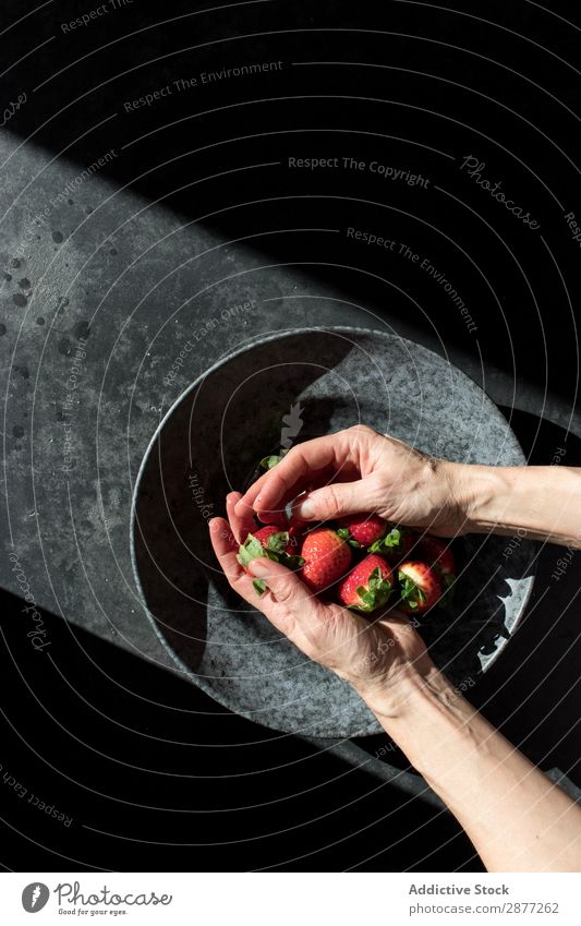 Hands with heap of strawberry near plate Strawberry Plate Heap Fresh Accumulation Bowl Sunbeam darkness Illuminate Fruit Food Sweet Red Dessert Healthy