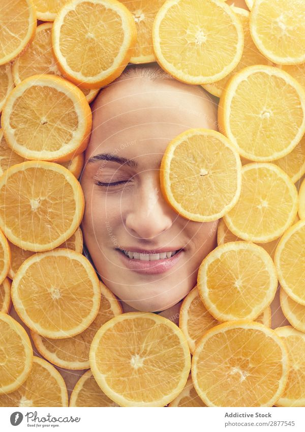 Smiling woman between slices of orange Face Woman Orange Slice Fresh Conceptual design Happy Youth (Young adults) Beautiful Beauty Photography Healthy