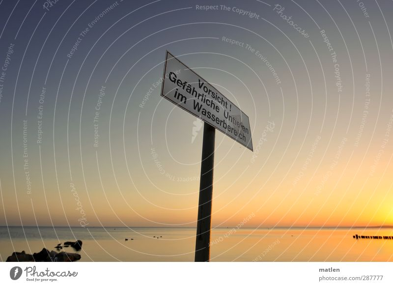 Where else;-)? Landscape Sky Cloudless sky Horizon Beautiful weather Rock Coast Ocean Metal Signs and labeling Signage Warning sign Blue Gold Competent groynes