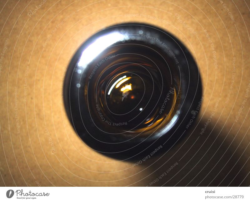 deep hole Round Bottle of beer Obscure Hollow Glass Neck of a bottle Bird's-eye view Isolated Image Bright background Rebus Opening
