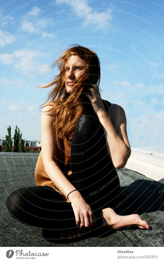 long-legged, redheaded model on a roof on a sunny, windy day Young woman Youth (Young adults) Body 18 - 30 years Adults Model Barefoot Red-haired Long-haired