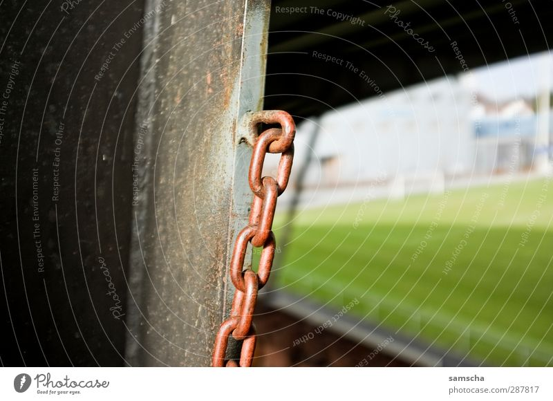 Old Wall (building) Wall (barrier) Metal Soccer Metalware Lawn Grass surface Rust Hang Chain Iron Iron chain Stadium Football pitch