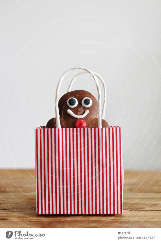 to give away a homemade dream man Food Dessert Candy Nutrition Eating Masculine Brown Red Gingerbread Man Paper bag Christmas & Advent Gift Donate Baked goods