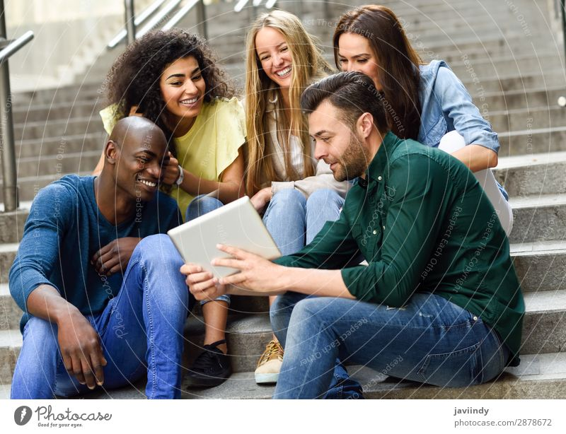 Multi-ethnic group of young people looking at a tablet computer outdoors Lifestyle Joy Happy Beautiful Human being Feminine Young woman Youth (Young adults)