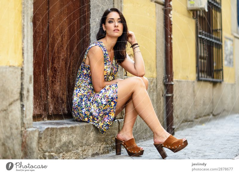 Beautiful young woman with blue eyes sitting on urban step. Lifestyle Style Hair and hairstyles Summer Human being Feminine Young woman Youth (Young adults)