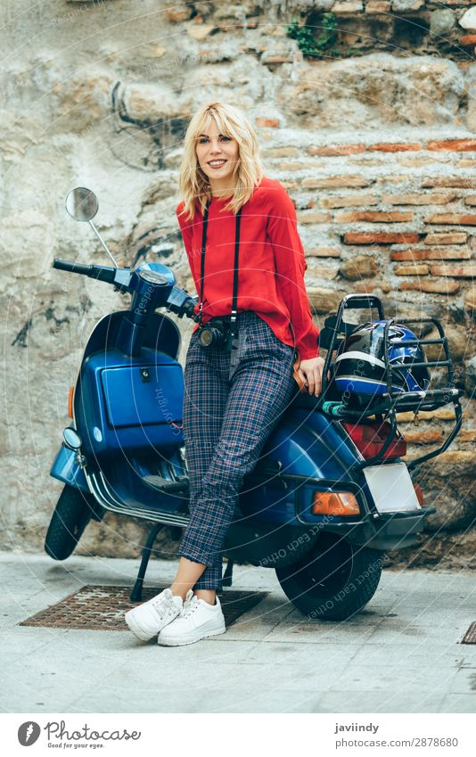 Woman sitting on an old blue scooter wearing red clothes. Lifestyle Style Happy Beautiful Hair and hairstyles Leisure and hobbies Vacation & Travel Tourism