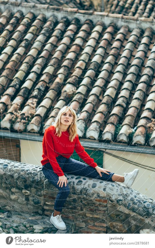 Woman sitting near beautiful roofs of charming old houses. Human being Youth (Young adults) Young woman Beautiful White Red 18 - 30 years Street Lifestyle