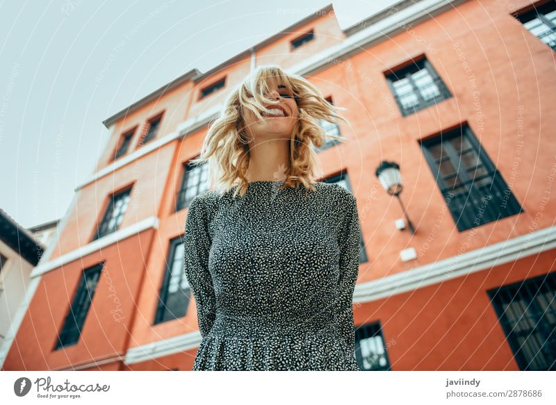Happy young woman with moving hair in urban background. Woman Human being Youth (Young adults) Young woman Summer Beautiful White 18 - 30 years Street Lifestyle