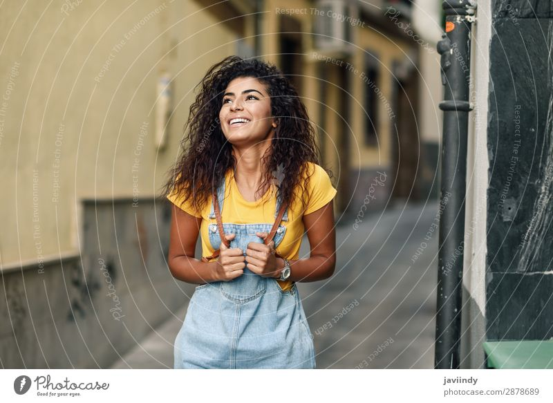 Young North African woman with black curly hairstyle outdoors. Lifestyle Style Happy Beautiful Hair and hairstyles Face Tourism Human being Feminine Young woman