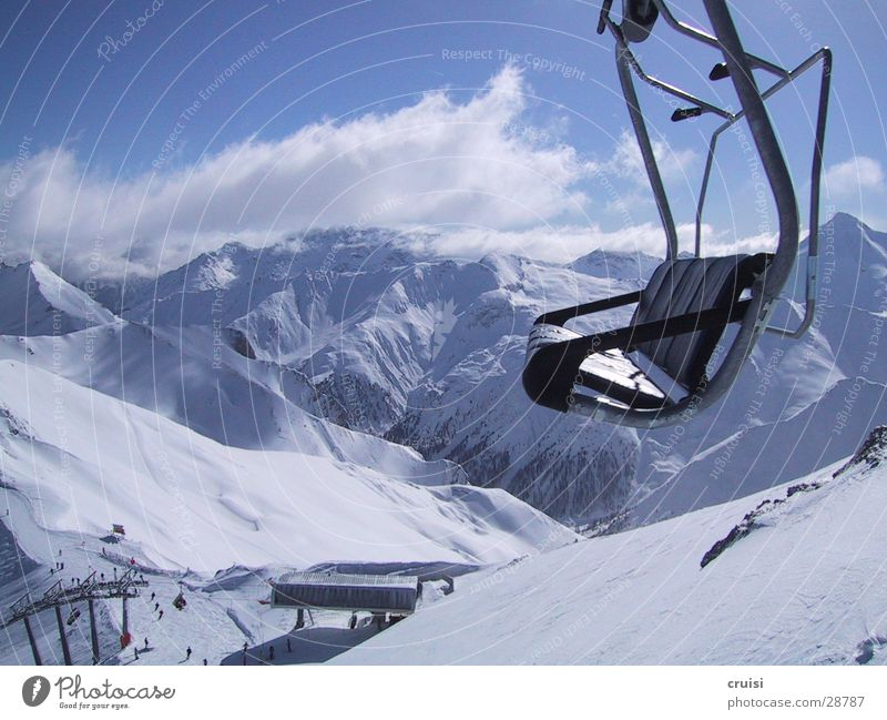 raised hide Winter vacation Deep snow Virgin snow Ischgl Armchair Chair lift Panorama (View) Alpine Sports Snow Mountain Alps powder Large