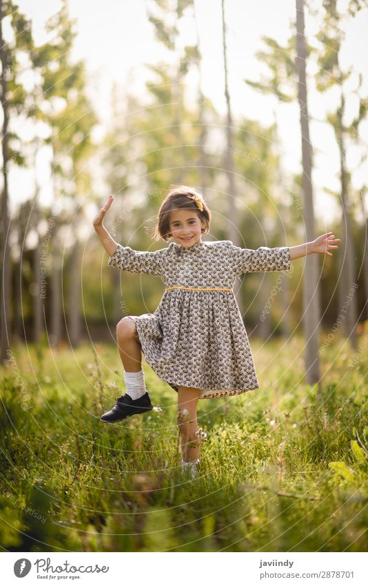 Little girl in nature field wearing beautiful dress Woman Child Human being Nature Summer Beautiful Flower Joy Girl Lifestyle Adults Meadow Emotions Happy Grass