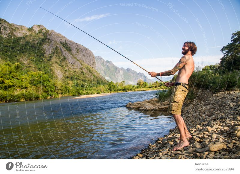 fisherman Man Human being Young man Fisherman Fishing (Angle) Fishing rod River Lake Lakeside River bank Hermit Facial hair Beard European Caucasian Smiling