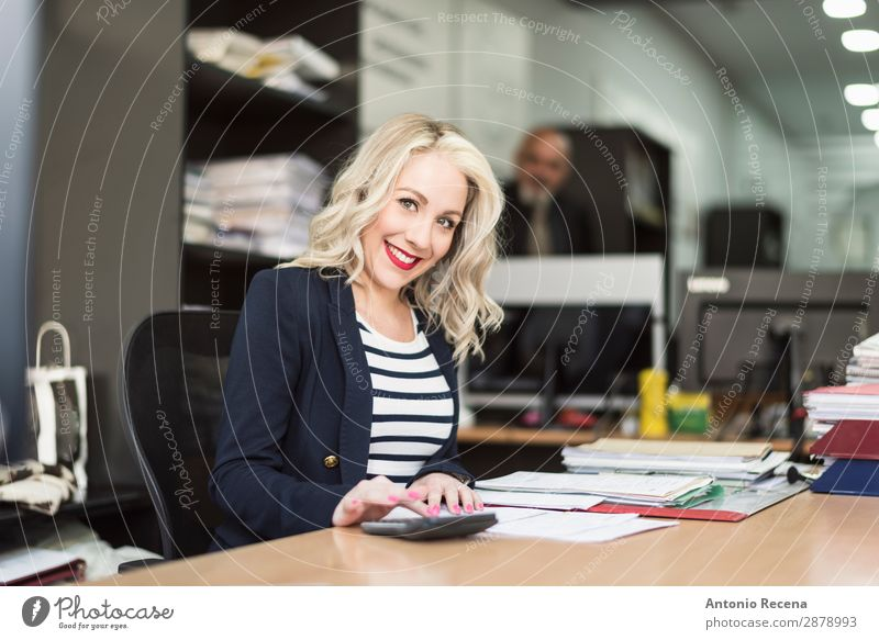 blonde 30s woman working at office and smiling Woman Human being Adults Business Work and employment Office Paper Telephone Profession Desk Suit Workplace