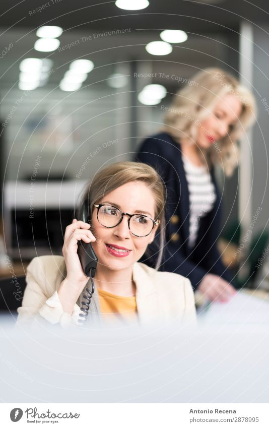 Attractive 30s woman working at office with telephone Woman Human being White Adults Business Work and employment Office Elegant Smiling Telephone