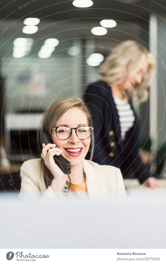 Secretary working Elegant Desk Work and employment Workplace Office Business Company Telephone Human being Woman Adults Suit Smiling To call someone (telephone)