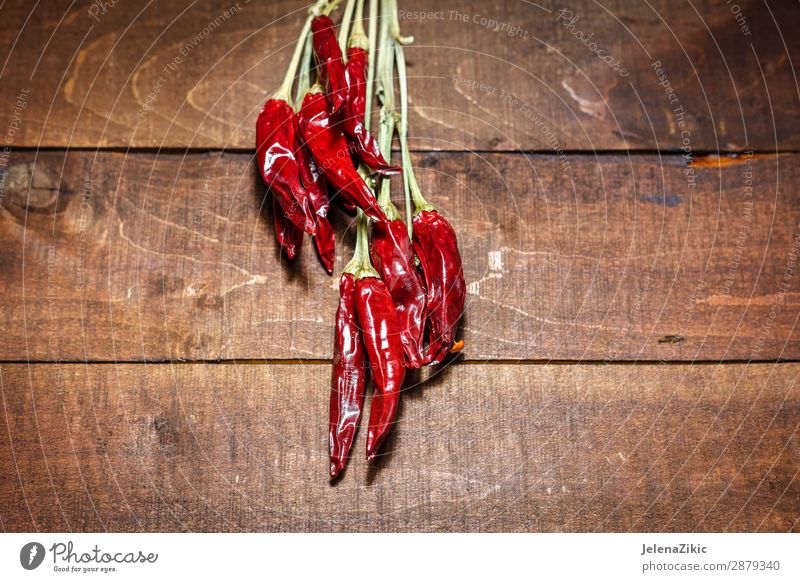 Red hot chili peppers on a wooden background Nature Healthy Eating Old Plant Colour Food Wood Natural Copy Space Nutrition Retro Fresh Table