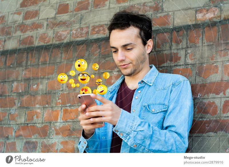 Man using smartphone sending emojis Lifestyle Happy Face Telephone PDA Screen Technology Internet Human being Adults Hand Funny Modern Smart Emotions young