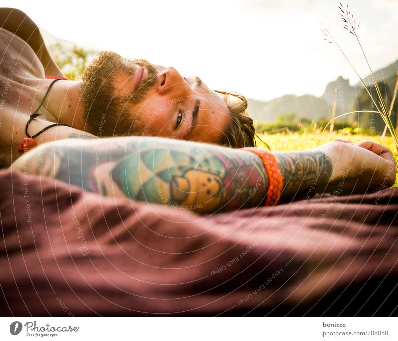 be flat Man Human being Lie Meadow Tattoo Tattooed Relaxation Calm Motionless Facial hair Beard Blanket Picnic Grass European Caucasian Loneliness Nature