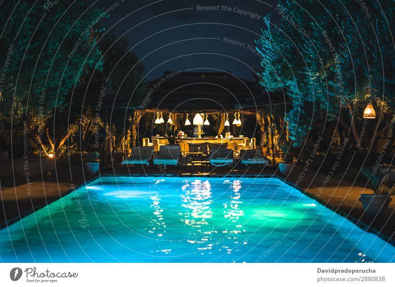 Swimming pool by night poolside Beautiful Landscape Relaxation Bar Vacation & Travel Summer Resort Lifestyle Luxury Lighting Night Exterior shot Twilight