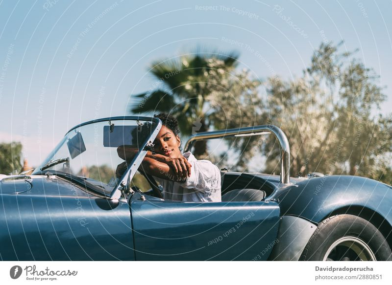 Black woman driving a vintage convertible car Woman Car Driving Ethnic Happy Convertible Street Luxury Looking away Smiling Profile Classic 60's Beautiful