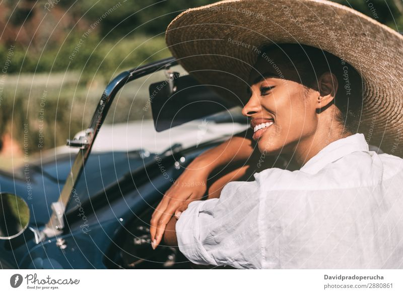 Black woman driving a vintage convertible car Woman Car Driving Ethnic Happy Convertible Street Luxury Looking away Cheerful Smiling Classic 60's Beautiful