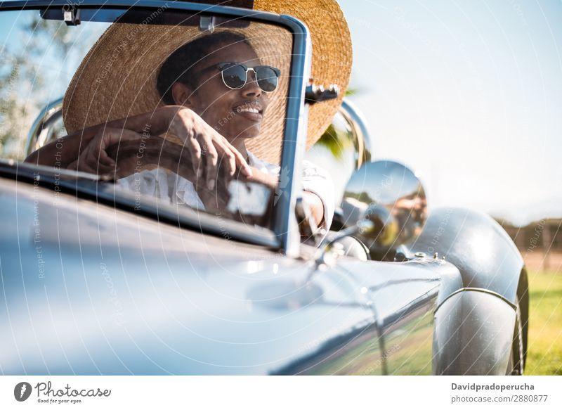 Black woman driving a vintage convertible car Woman Car Driving Ethnic Convertible Street