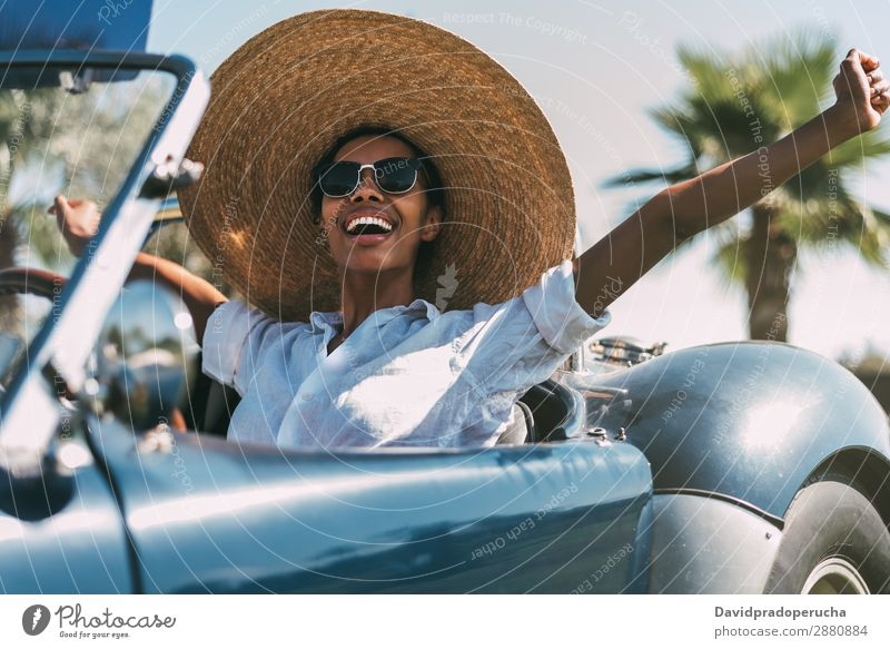 Black woman driving a vintage convertible car Woman Car Driving Ethnic Convertible Transport Street Luxury Looking away Cheerful Happy Smiling Vintage Classic