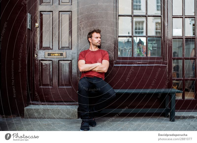 Man sitting in a bench on a beautiful maroon background Caucasian Building Youth (Young adults) Architecture Vintage Notting Hill decor Street Sit Summer