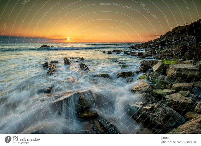Long time exposure of water surrounded rocks in the sea with sunset Rock Deep depth of field Evening Long exposure Sunset Sunrise Sunlight Contrast Deserted