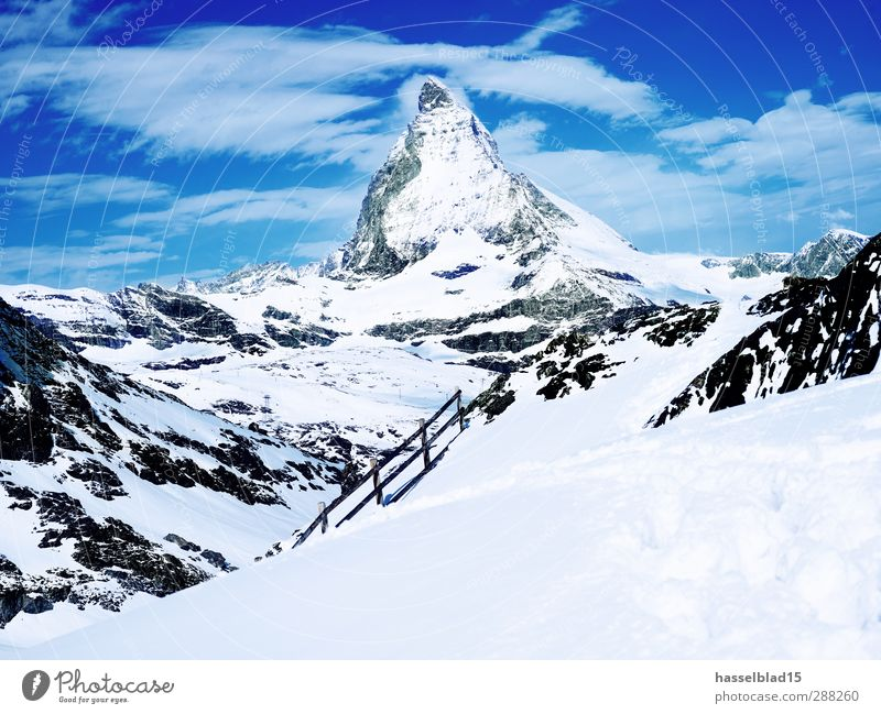 Matterhorn Winter Sports Winter sports Ski run Nature Landscape Sky Beautiful weather Snow Alps Mountain Peak Snowcapped peak Glacier Cold Zermatt Footprint