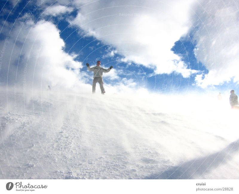 White Winter Cold Snow Sports Ice Wind Gale Downward Clouds in the sky Snowboarding Snowboarder Hands up!