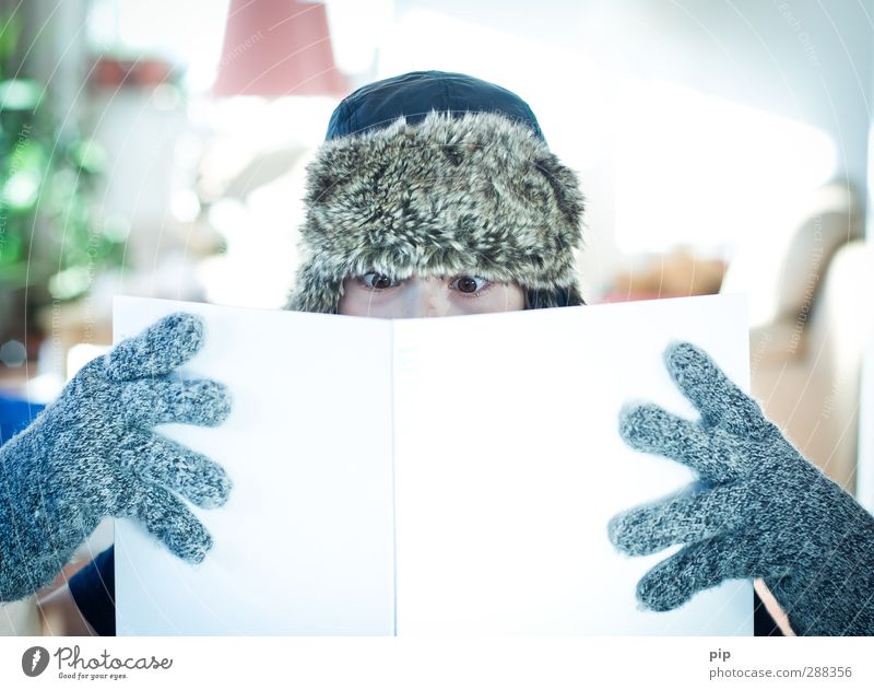 Human being Eyes Cold Boy (child) Masculine Book Fingers Study Reading Education Cap Print media Gloves Literature Exciting Booklet