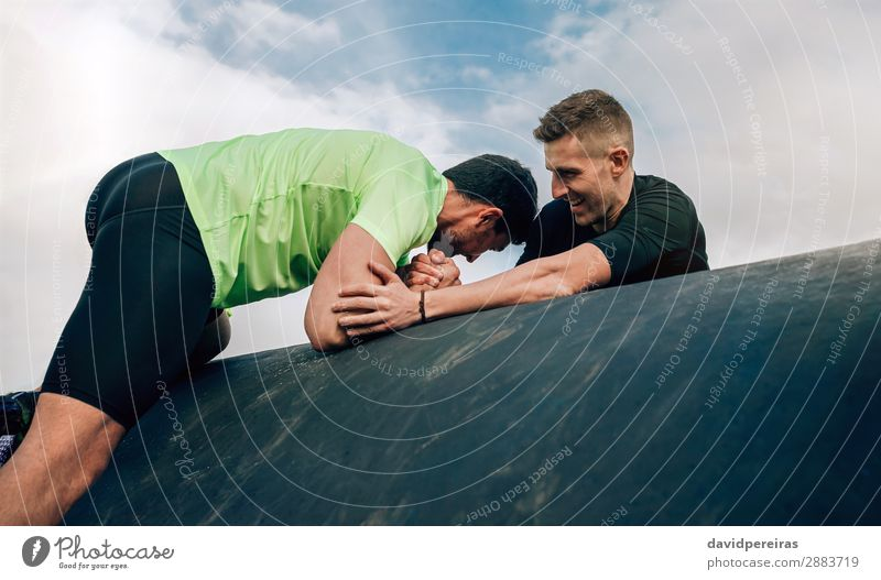 Men in an obstacle course climbing a drum Lifestyle Joy Sports Climbing Mountaineering Human being Man Adults Hand To enjoy Authentic Strong Effort Teamwork