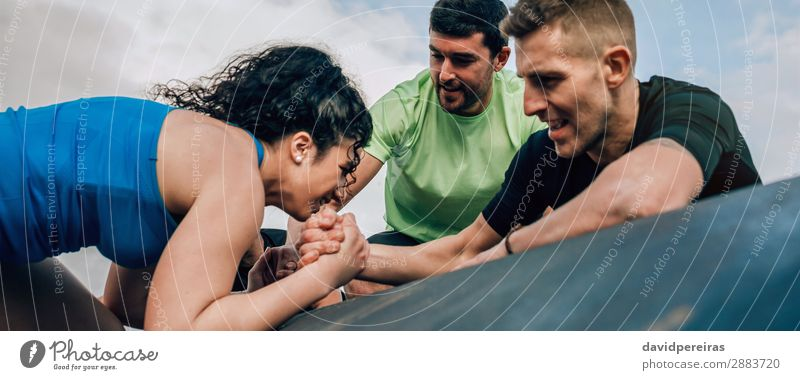 Woman in an obstacle course climbing a drum Sports Climbing Mountaineering Internet Human being Adults Man Hand Group Fitness Authentic Strong Pain Effort