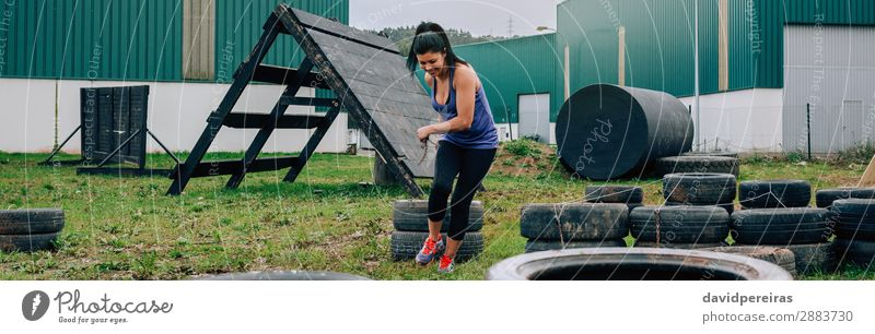 Participant in an obstacle course dragging wheels Joy Happy Sports Internet Human being Woman Adults Grass Smiling Authentic Strong Power Loneliness Effort