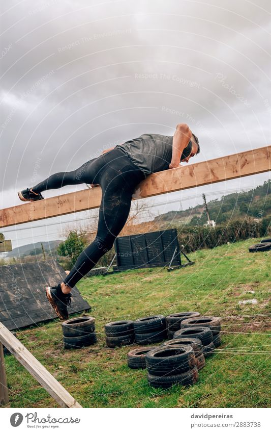 Participant in a obstacle course doing irish table Lifestyle Sports Human being Man Adults Wood Authentic Strong Power Effort Competition obstacle course race