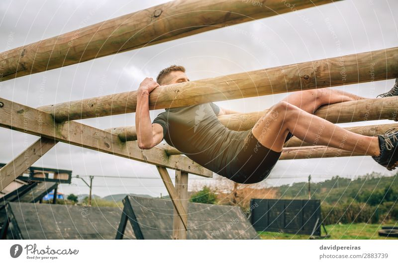 Participant in a obstacle course doing weaver Lifestyle Sports Human being Man Adults Wood Authentic Above Strong Power Effort Competition weaver obstacle
