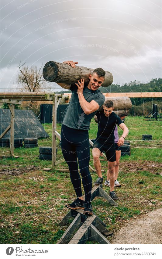Group carrying trunks Joy Happy Contentment Sports Human being Woman Adults Man Fitness Smiling Carrying Authentic Strong Power Effort Competition