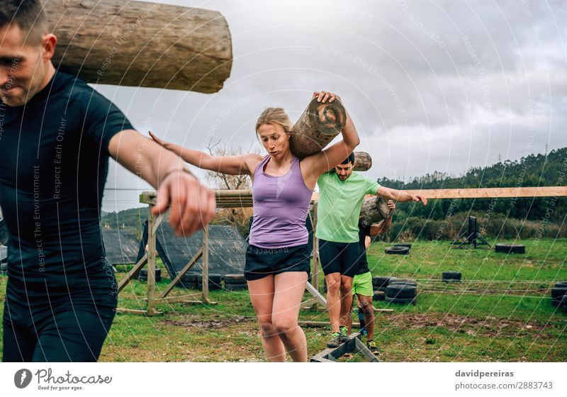 Group carrying trunks Contentment Sports Human being Woman Adults Man Carrying Authentic Strong Power Effort Competition balance exercise Tree trunk walking