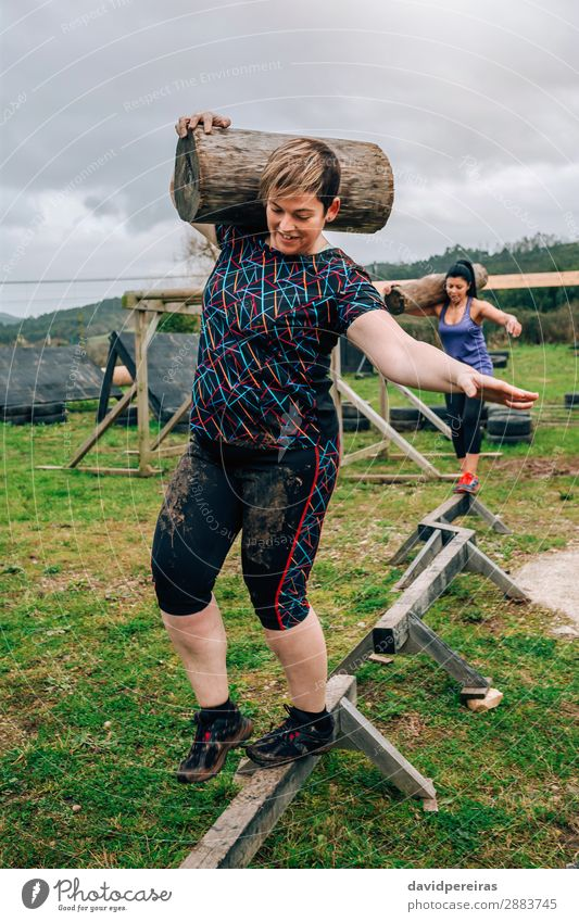 Two participants carrying trunks Contentment Sports Human being Woman Adults Man Smiling Carrying Authentic Dirty Strong Power Effort Competition