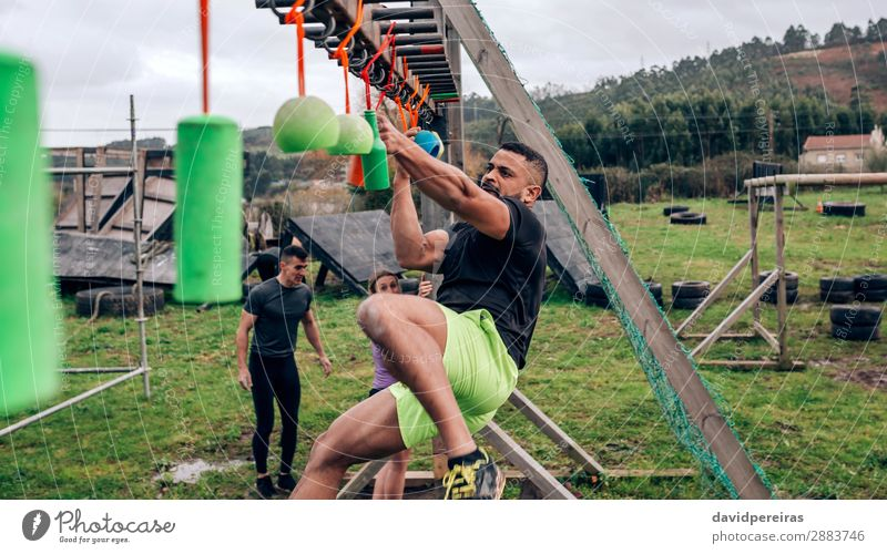 Participant obstacle course doing suspension Sports Human being Woman Adults Man Arm Group Fitness Hang Authentic Strong Black Power Effort Competition