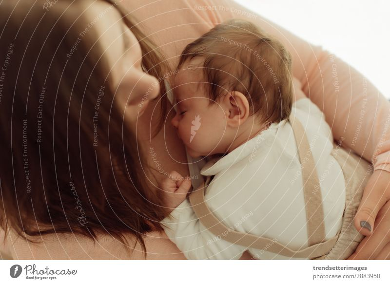 Young Mother holding newborn baby Eating Happy Beautiful Child Baby Woman Adults Parents Family & Relations Infancy Arm Feeding Love Small White Protection