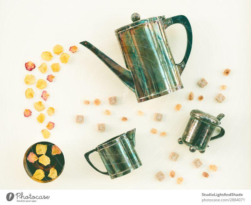 Vintage tea set and cup of tea with rose petals Beverage Tea Flower Metal Bright Retro Yellow Green White Colour Teatime Tea cup mug Teapot Kettle Sugar bowl