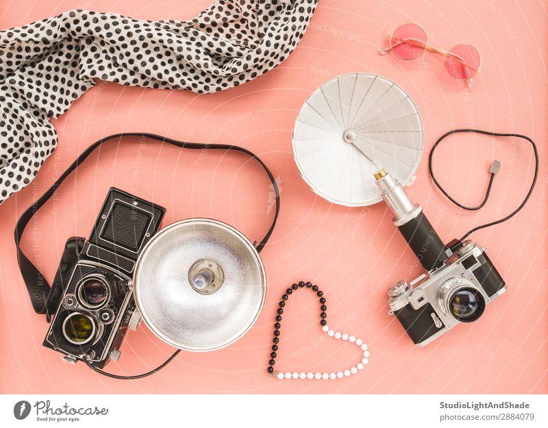 Vintage photo cameras on pink background Laboratory Camera Jewellery Sunglasses Scarf Old Retro Pink Black White Colour Nostalgia Photography flash vintage