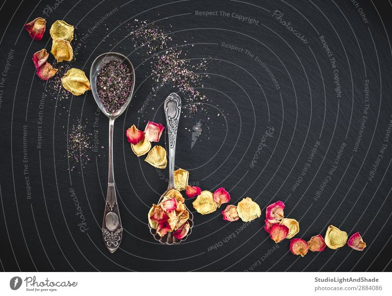 Silver spoons with floral tea and rose petals Herbs and spices Beverage Tea Cutlery Spoon Design Beautiful Fragrance Nature Flower Rose Leaf Blossom Metal Dark