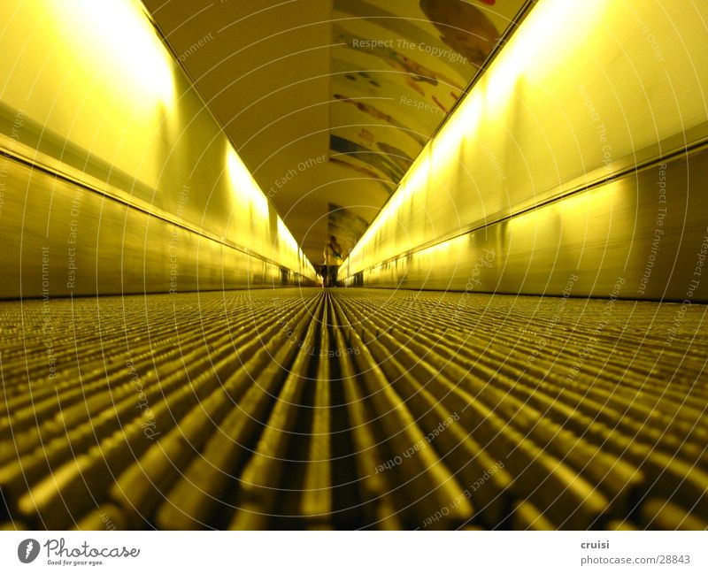 Yellow Far-off places Tunnel Underground Obscure Neon light Commuter trains Escalator Moving pavement Vanishing point