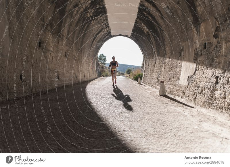 Runner in tunnel Lifestyle Happy Sports Human being Woman Adults 1 Nature Park Brunette Fitness young people healthy fit Beauty Photography athlete workout